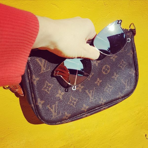 Louis Vuitton bag and mirror style sunglasses